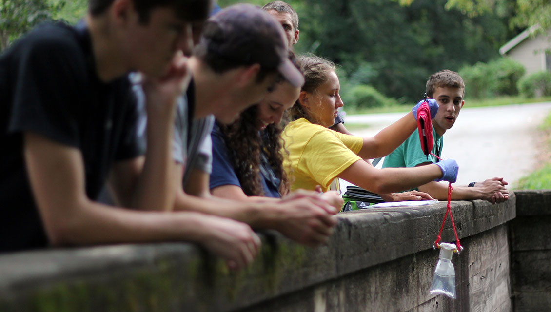 students testing river water